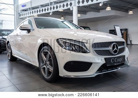 GDANSK, POLAND - FEBRUARY 13, 2018: New Mercedes E cabrio in the car showroom of Gdansk, Poland. Mercedes-Benz is German luxury  automobile manufacturer located in Stuttgart.
