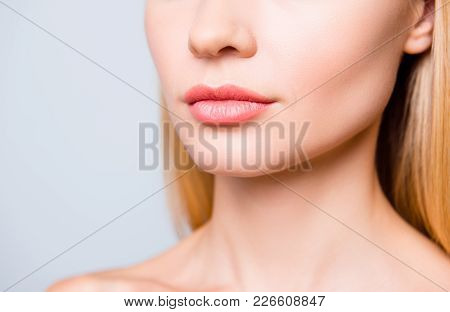 Close Up Cropped Photo Of Big Natural Woman's Lips Without Lipstick And Perfect Skin.
