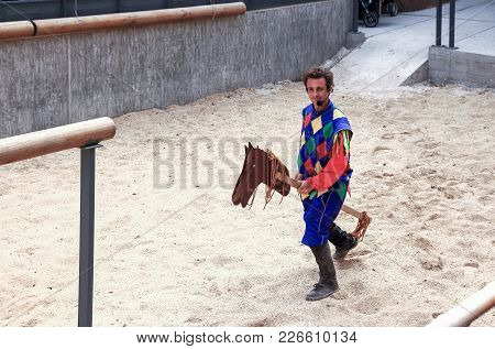 Acre, Israel, April 09, 2015 : The Clown On A Wooden Horse Gallops On The List In The Fortress Of Th