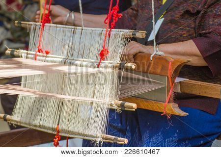 Old Women Are Using The Machine - Household Loom Weaving - For Homemade Silk Or Textile Production O