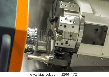 The  Cnc Lathe Machine Cutting The Stainless Thread Part