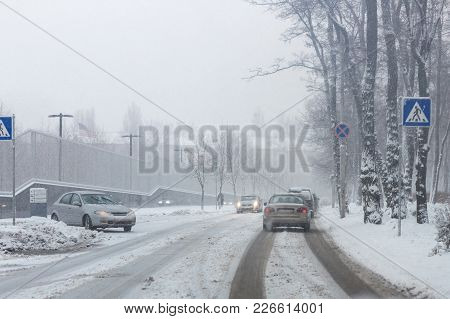 City Street Under Snow During Heavy Blizzard In Winter.  Poor Snow Removal. Shower   Precipitation.