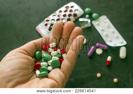 Colorful Pills And Medicines In The Hand. Concept - Suicide, Overdose, Uncontrolled Use Of Antibioti