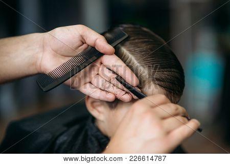 The Boy Getting Haircut By Scissor In Barbershop. Barber Use Scissor.
