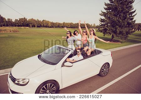 Full Length Of Ladies And Guy Driver, Chics Girlfriends Express Emotions, Success, Feel Wind. Five F