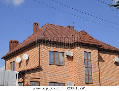 Decorative Metal Tile On A Roof. Types Of A Roof Of Roofs. Decorative Metal On The Roof Of The House