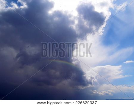 A Tiny Rainbow Hidden In The Clouds,