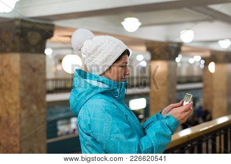 Woman Read The Message On Phone In The Moscow Metro In Russia