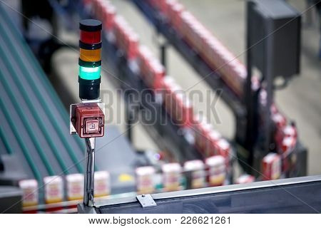 Green Light Showing Production Line In Background Is Working Properly. Manufacturing Production Line
