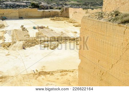Victoria, Malta - 30 October 2017: Limestone Quarry Industry At Gozo Island On Malta