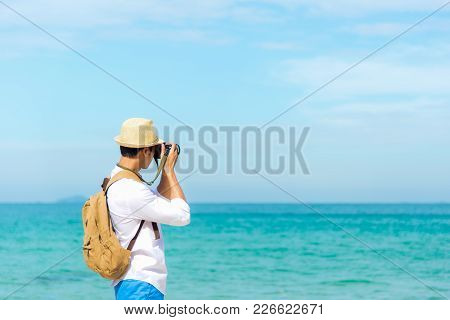 Summer Day.  Happy Smiling Caucasian Tourist Asian Young Man Holding Camera For Take A Photo Check I