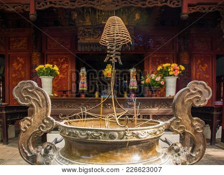 An Incense Burner In The Historic Quan Thanh Temple In The Ba Dinh District Of Hanoi, Vietnam. The T