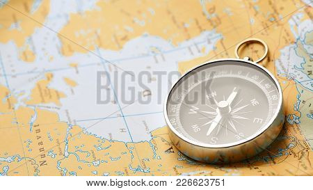 Compass On The Tourist Map. Navigation Tools To Orient. Conceptual Of Tourism