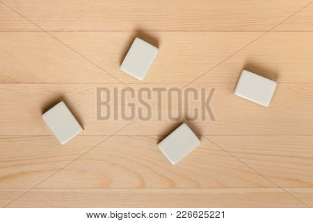 Empty White Tiles For Mahjong On Brown Table