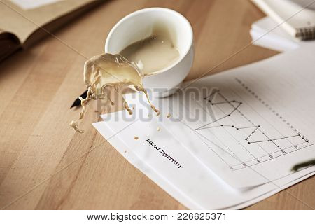 Coffee In White Cup Spilling In Slow Motion Or Movement On The Table With Documentation In The Morni