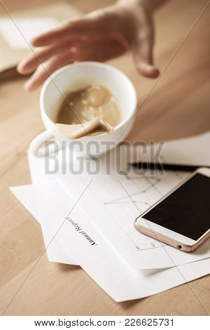 The Male Hands And Coffee In White Cup Spilling In Slow Motion Or Movement On The Table With Documen