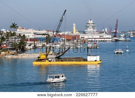 The Motorboat Passing By In Busy Nassau City Port (bahamas).