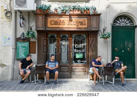 People Drinking On A Cafe Of Victoria On Gozo Island