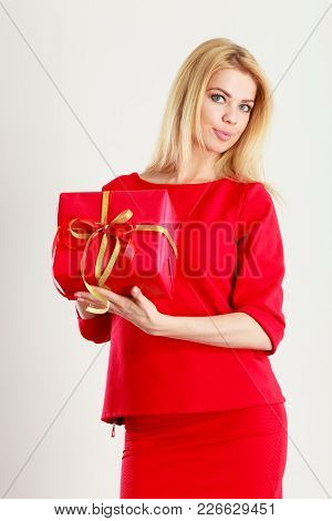 Occasions Gifts People Concept. Beautiful Woman With Red Gift. Young Blonde Lady Wearing Nice Outfit