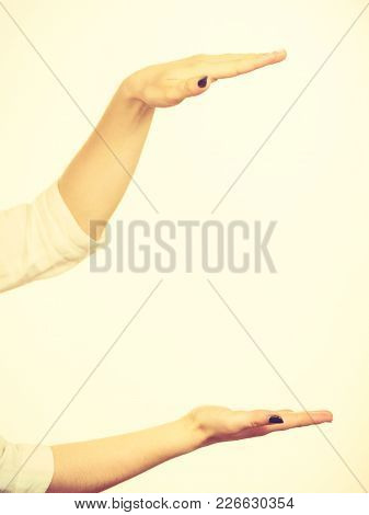 Woman Showing Presenting, Girl Uses Hands To Indicate Area Of Frame, Copy Space For Product, Graphic