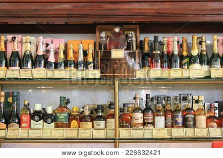 St. Petersburg, Russia - February 8, 2018: Bar Alcohol Top Shelf With Various Drink Bottles. Whiskey