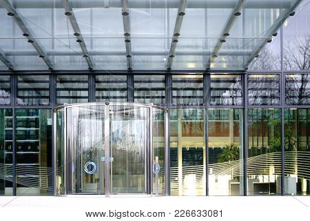 Mainz, Germany - February 10: The Glass Entrance Of Schott Ag Headquarters In Mainz With A Revolving