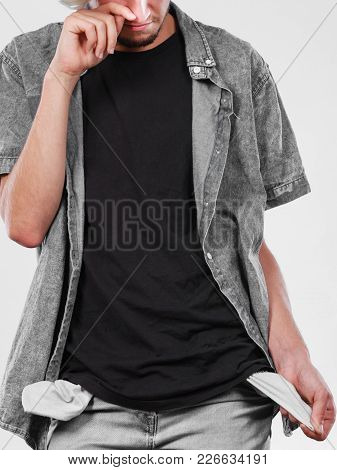 Financial Difficulties, Bad Economy, No Money Concept. Young Man Male Student Showing Empty Pockets,