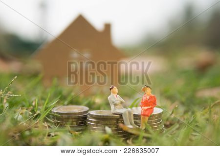 A Couple Of Male And Female Are Discussing About House Renting Or Buying From Bank With Some Coin Mo
