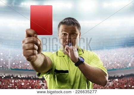 Referee Showing The Red Card In The Soccer Stadium Focus On Card