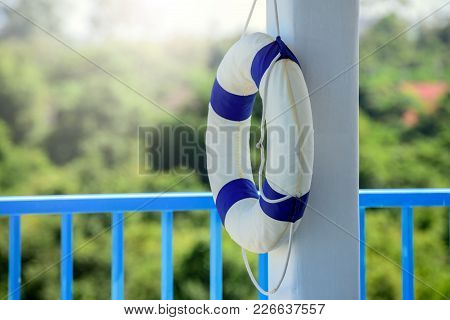 Safety Equipment, Life Buoy Or Rescue Buoy Floating On Swimming Pool To Rescue People From Drowning