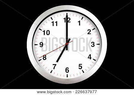It's Seven O'clock Already, Time To Wake Up For Breakfast, Modern White Metallic Alarm Clock On Blac