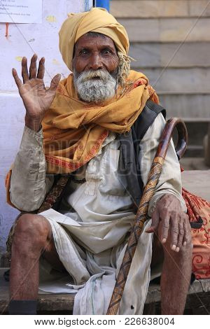 Pushkar, India - February 25: An Unidentified Man Sits In The Street On February 25, 2011 In Pushkar