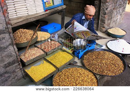 Pushkar, India - February 25: An Unidentified Man Sells Food In The Street On February 25, 2011 In P
