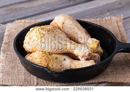 The Concept: Home Cooking. Raw Chicken Legs Are Cooked For Frying
