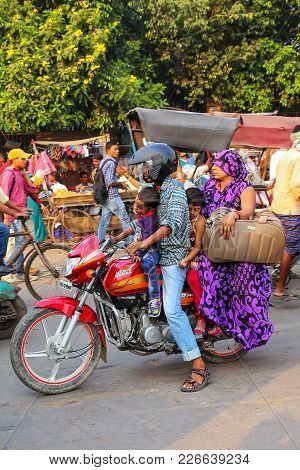 Agra, India - November 10: Unidentified People Ride Motocycle At Kinari Bazaar On November 10, 2014