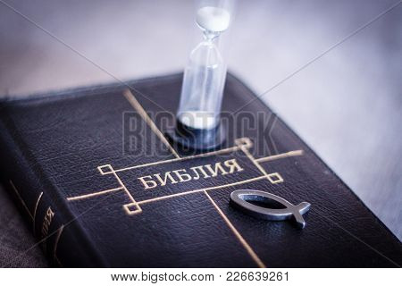 Image Of Book Bible Close-up In Leather Black Binding With Zipper With Christian Fish Icon And Hourg