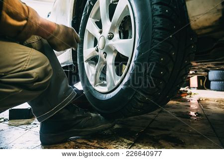 Wheel Balancing Or Repair And Change Car Tire At Auto Service Garage Or Workshop By Mechanic, Toned