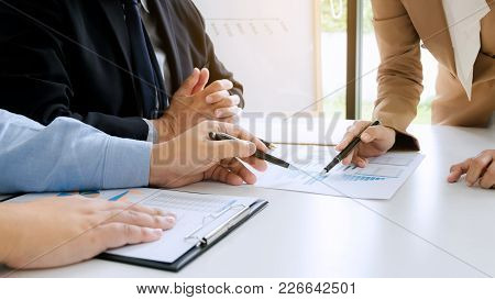 Business Executives Brainstorming Discussing Sale Performance On New Project In Modern Office Room