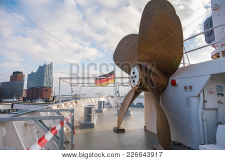 Hamburg, Germany - January 2018. A Huge Propeller Ship On The Deck With A View Of The German Flag An