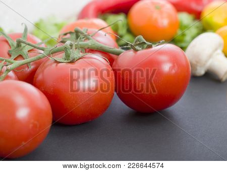 Tomatoes On The Table. Red Tomatoes Lie On The Old Table. Dietary Food. Tomatoes On The Table On The