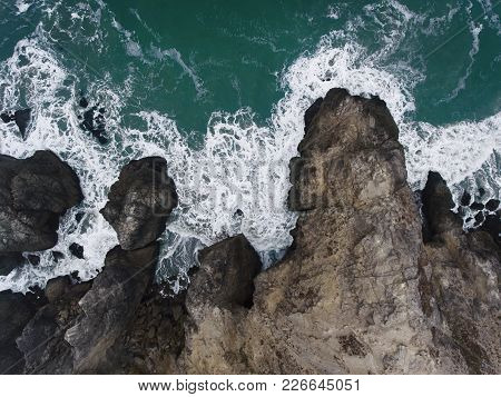 Aerial, Overhead View Of A Rocky Shoreline In Northern California.
