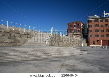 Photo Of Several Steps With Blue Sky, Building Facade And Sunlight