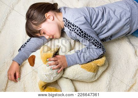 Girl Taking A Nap While Hugging Her Toy