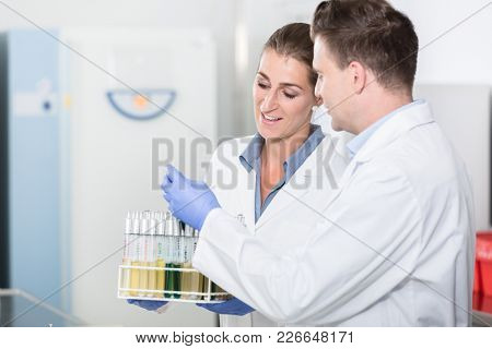 Lab assistants in research laboratory preparing samples for scientific test