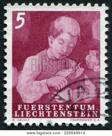 Liechtenstein - Circa 1951: A Stamp Printed In The Liechtenstein, Shows A Boy With A Knife Cutting B