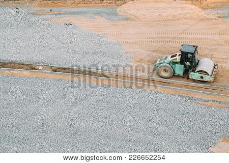 Minsk, Belarus. Vibrating Roller At Work On City Building Site. Construction Of Houses.