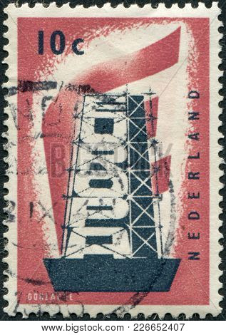Netherlands - Circa 1956: A Stamp Printed In The Netherlands, Shows A Character Rebuilding Europe, C
