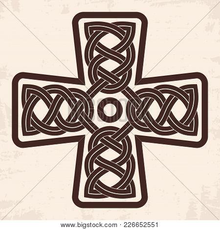 Celtic Cross With National Ornament As Interlaced. Old Beige Background With The Aging Effect.