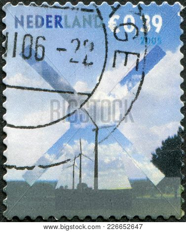 Netherlands - Circa 2005: A Stamp Printed In The Netherlands, Is Shown Building Silhouettes, Wind Ge