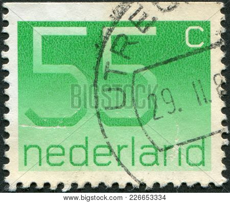 Netherlands - Circa 1981: A Stamp Printed In The Netherlands, Shows The Value Of A Postage Stamp, Ci